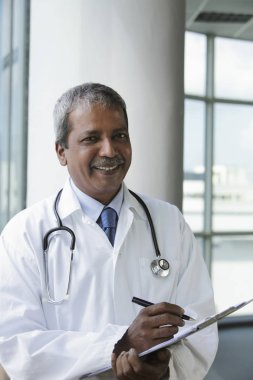 Indian Doctor  with grey hair