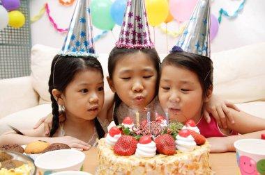 Little girls celebrating a birthday