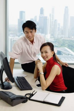 Executives in office looking camera