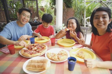 Family having pizza at home