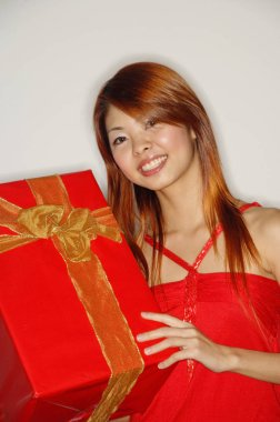 Woman holding red gift box