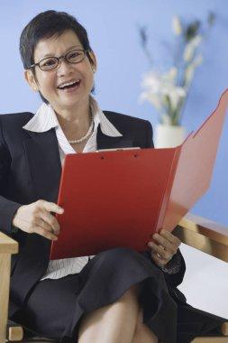 Businesswoman holding clipboard