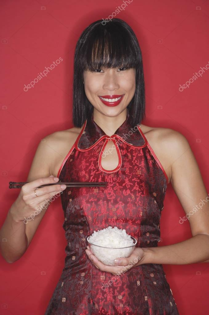 Woman holding bowl of rice