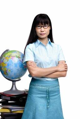 Woman standing next to globe