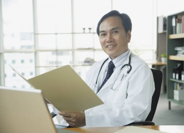 Doctor sitting in office