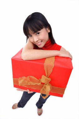 woman holding big red gift box