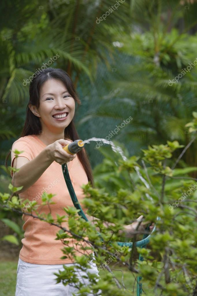 Woman pruning plant