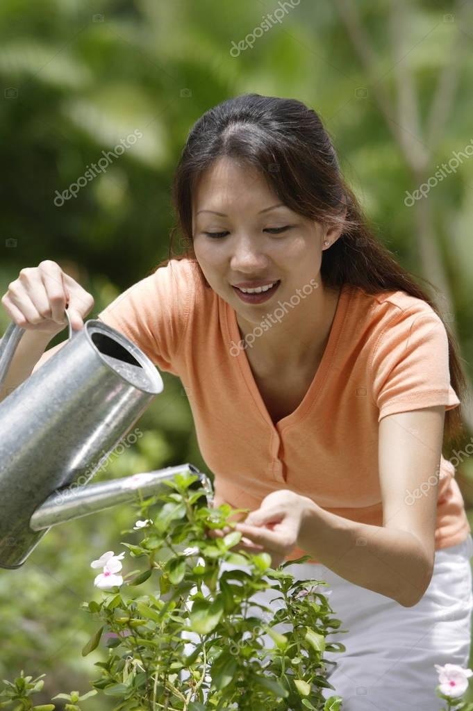 asian Woman work in garden
