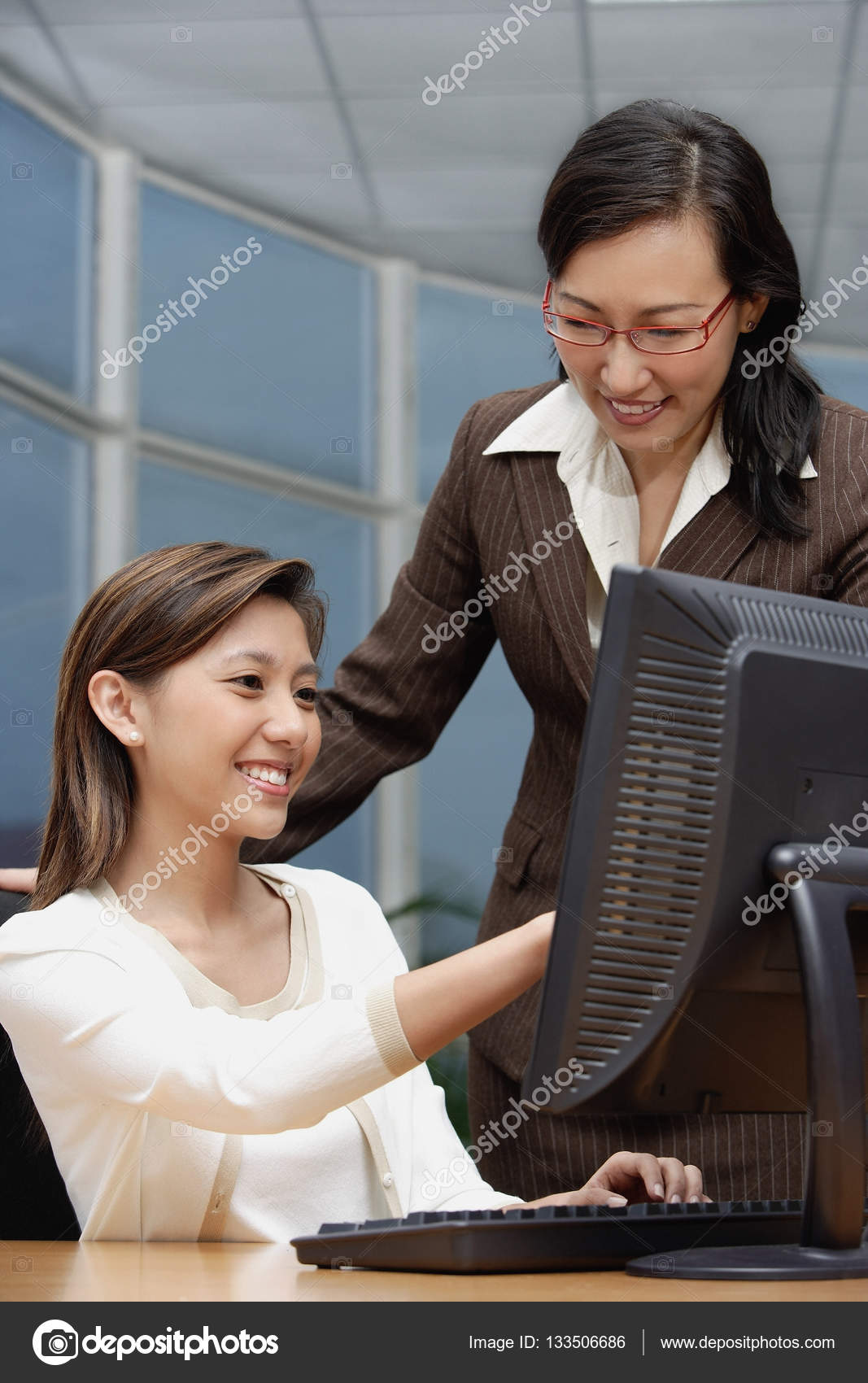 Female executives looking at computer — Stock Photo