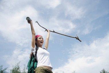 Female hiker, holding hiking stick