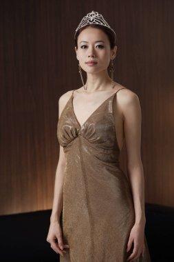 Woman in brown dress