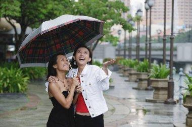 Women standing under umbrella