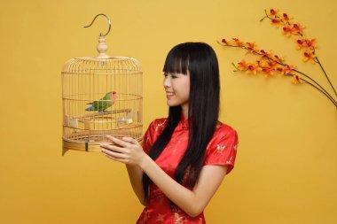 woman holding lovebird