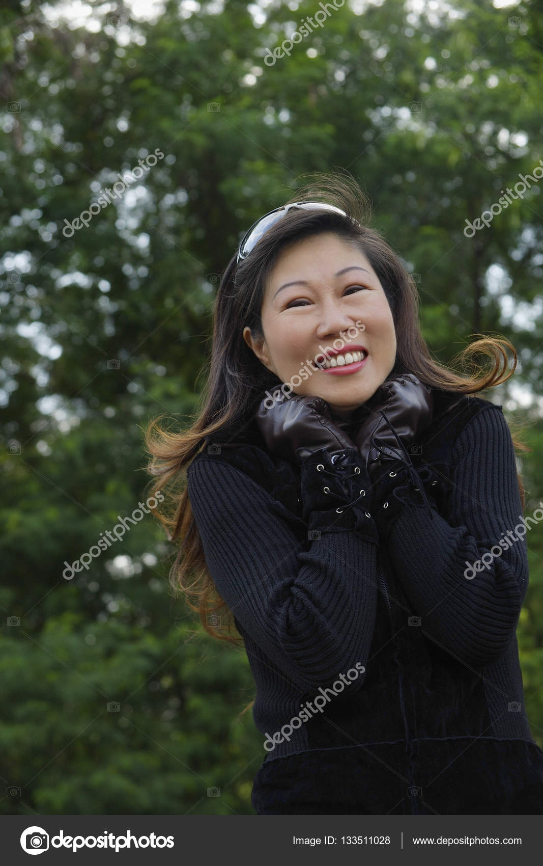 mature woman wearing leather gloves — stock photo © microstockasia