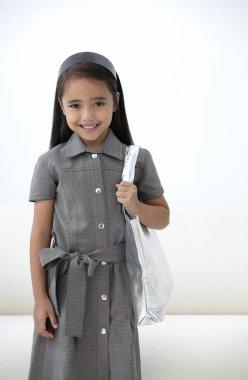 young girl dressed in school uniform
