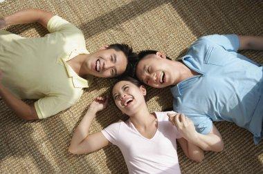 Friends lying on floor