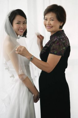 bride and her mother smile
