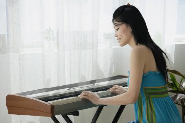 Young woman with keyboard