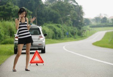 A woman with car trouble calls