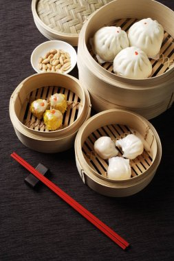 Assortment of dim sum in bamboo steamers.
