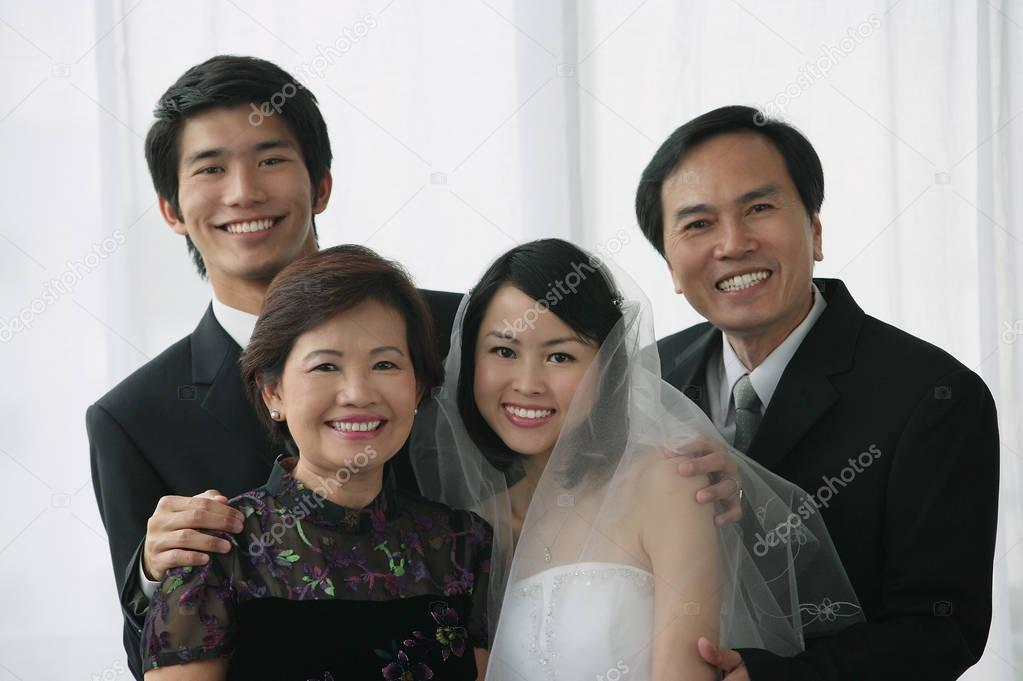 newlywed couple and family