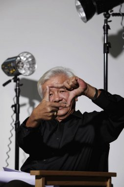man sitting on film set