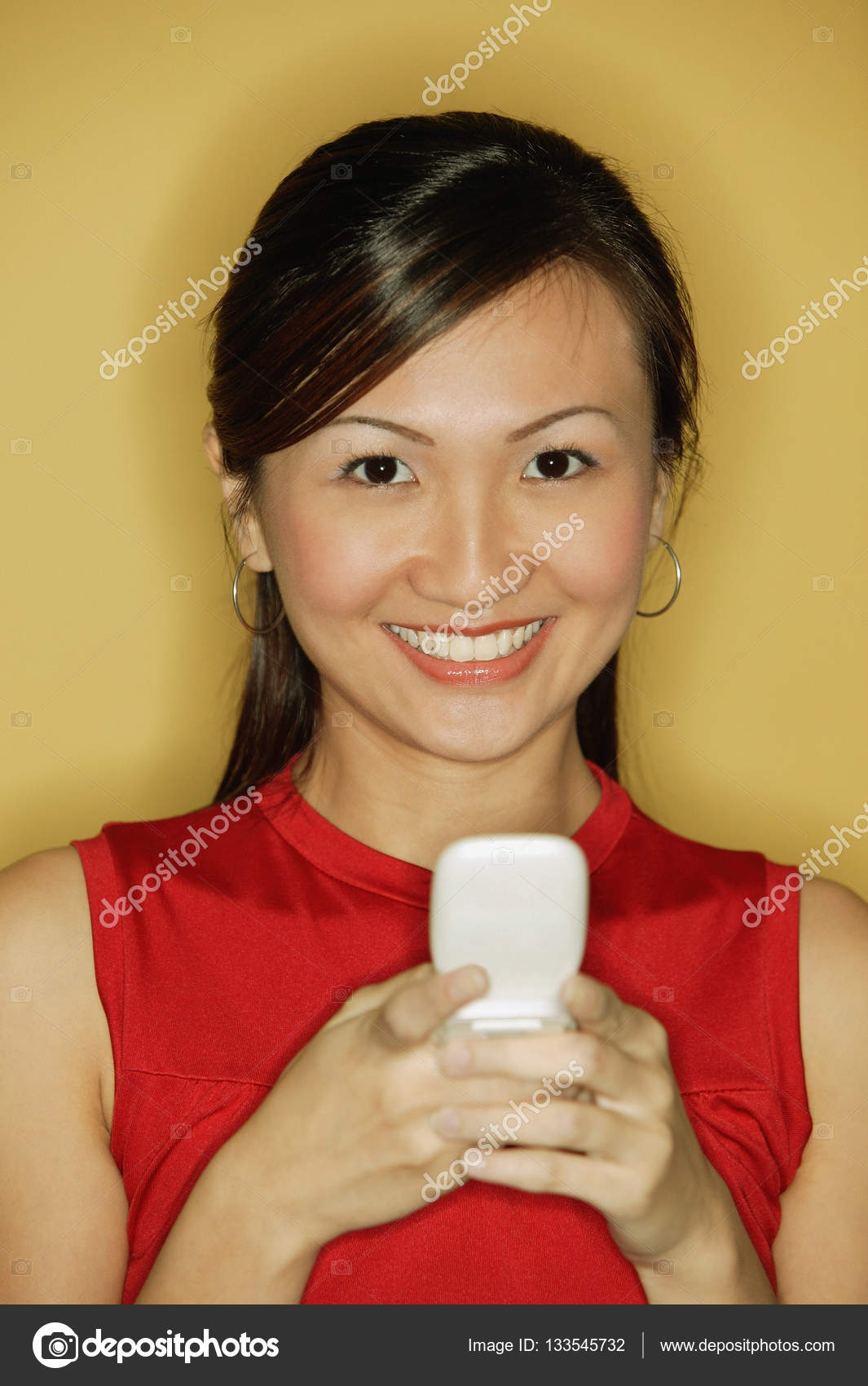 80ea81ac63d Young woman wearing a red top — Stock Photo © MicrostockAsia  133545732