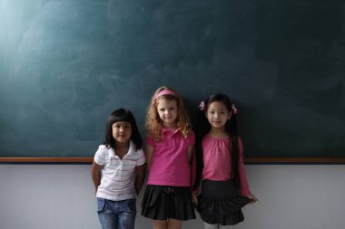 three young schoolgirls