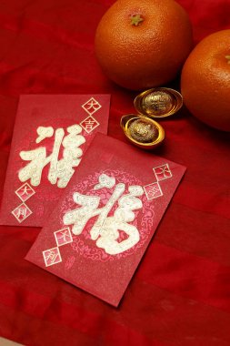Gold ingots on red envelopes