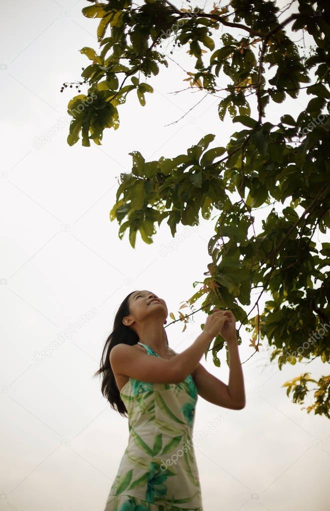 woman touching tree branch