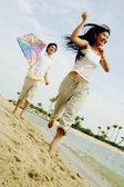 Létající drak pár na pláži