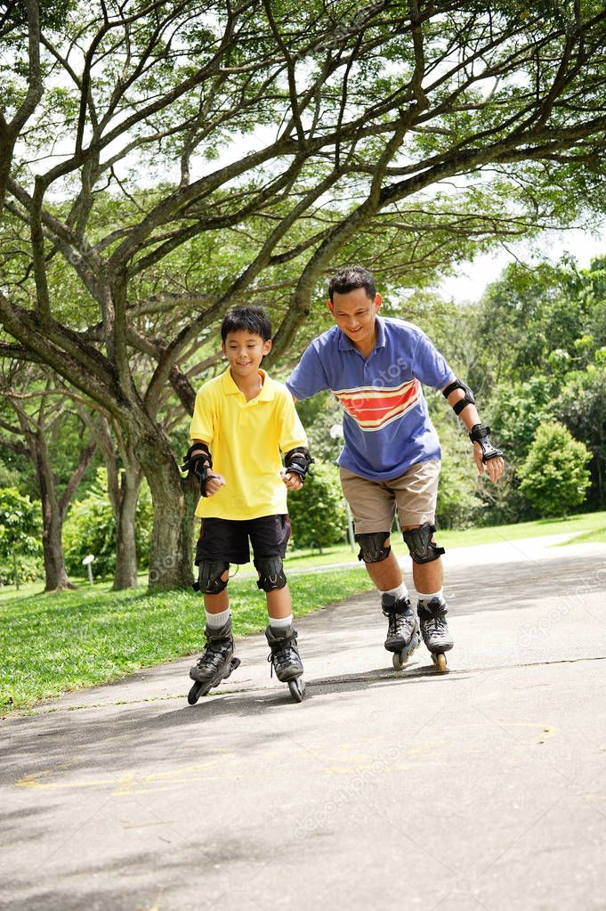 Father and son on roller blades