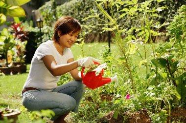 Smiling woman gardening