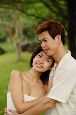 Asian Couple embracing