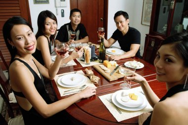 Adults having dinner party