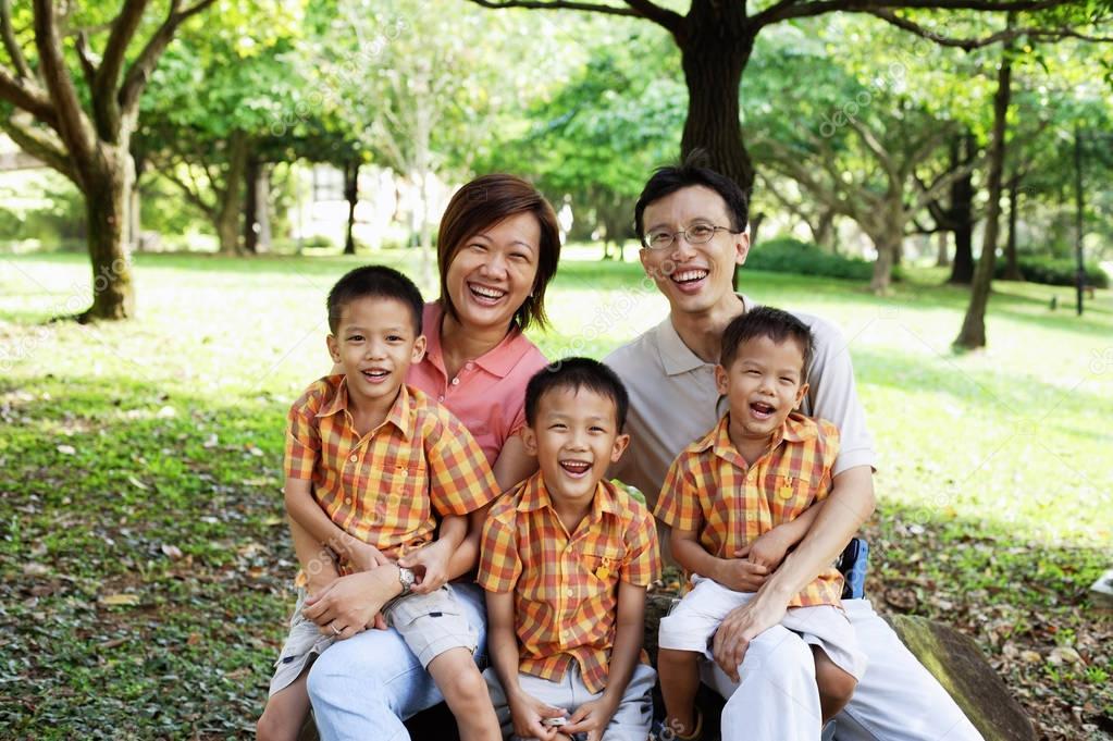 Family with three boys outdoors