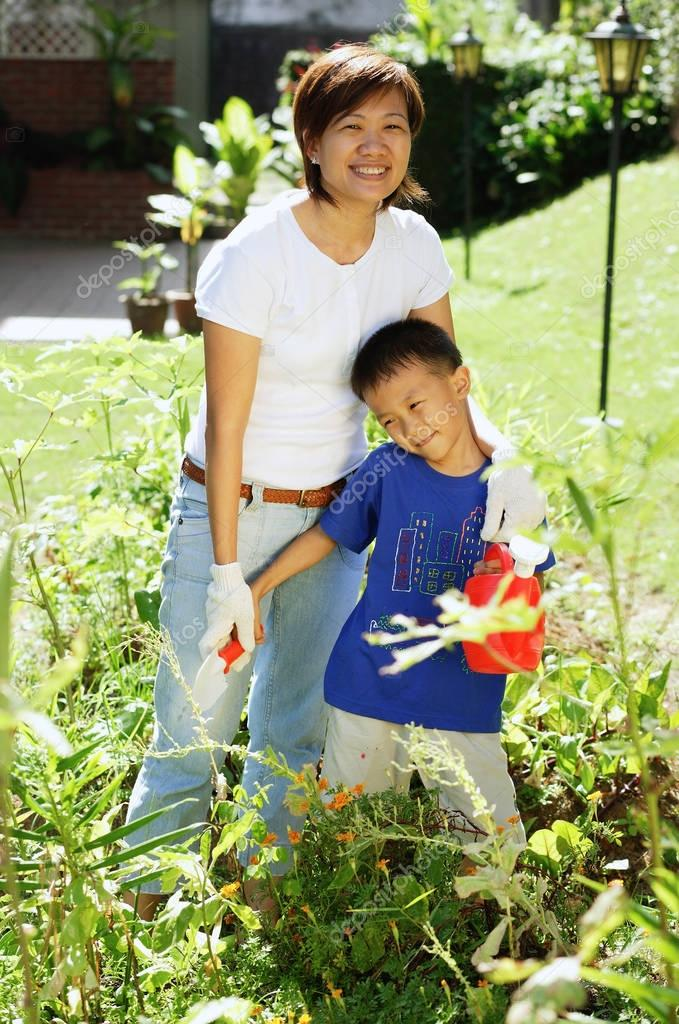 Mother and son in garden