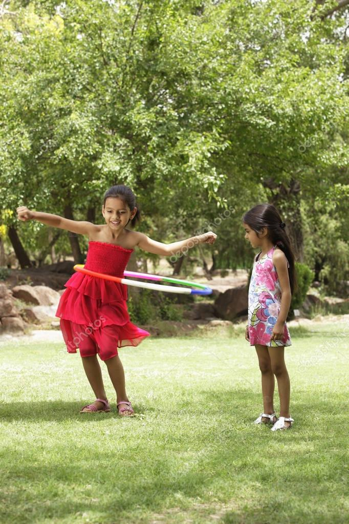 girls playing with hula hoop