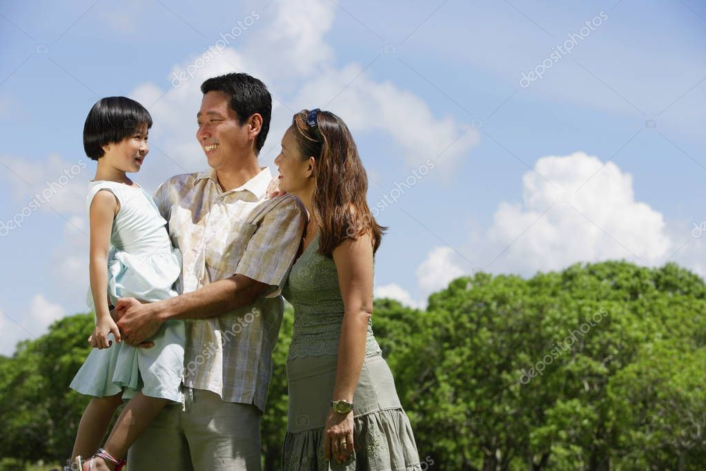 Asian Family enjoying family time together in the park