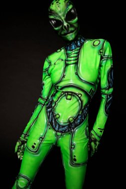 model in suit of green alien