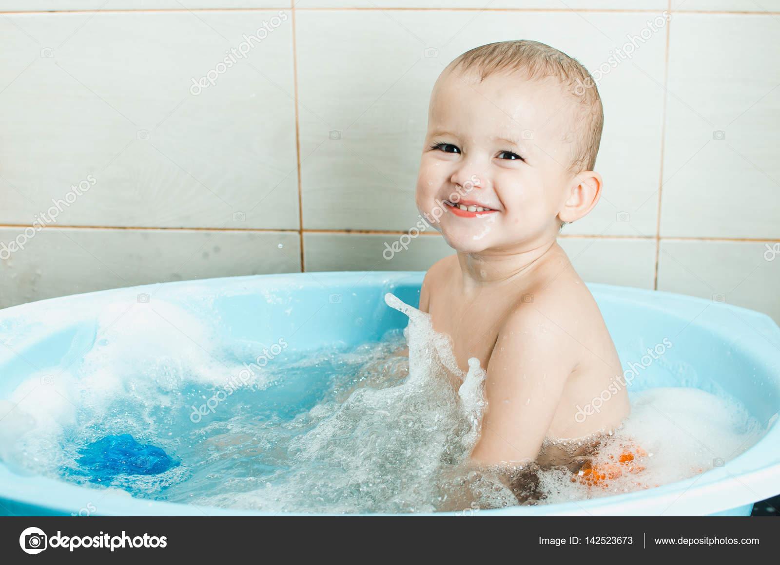 Happy baby boy taking a bath — Stock Photo © Komokvm #142523673