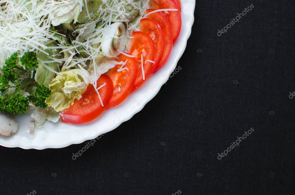 On a dark fabric background iceberg lettuce, with quail eggs, flat lay