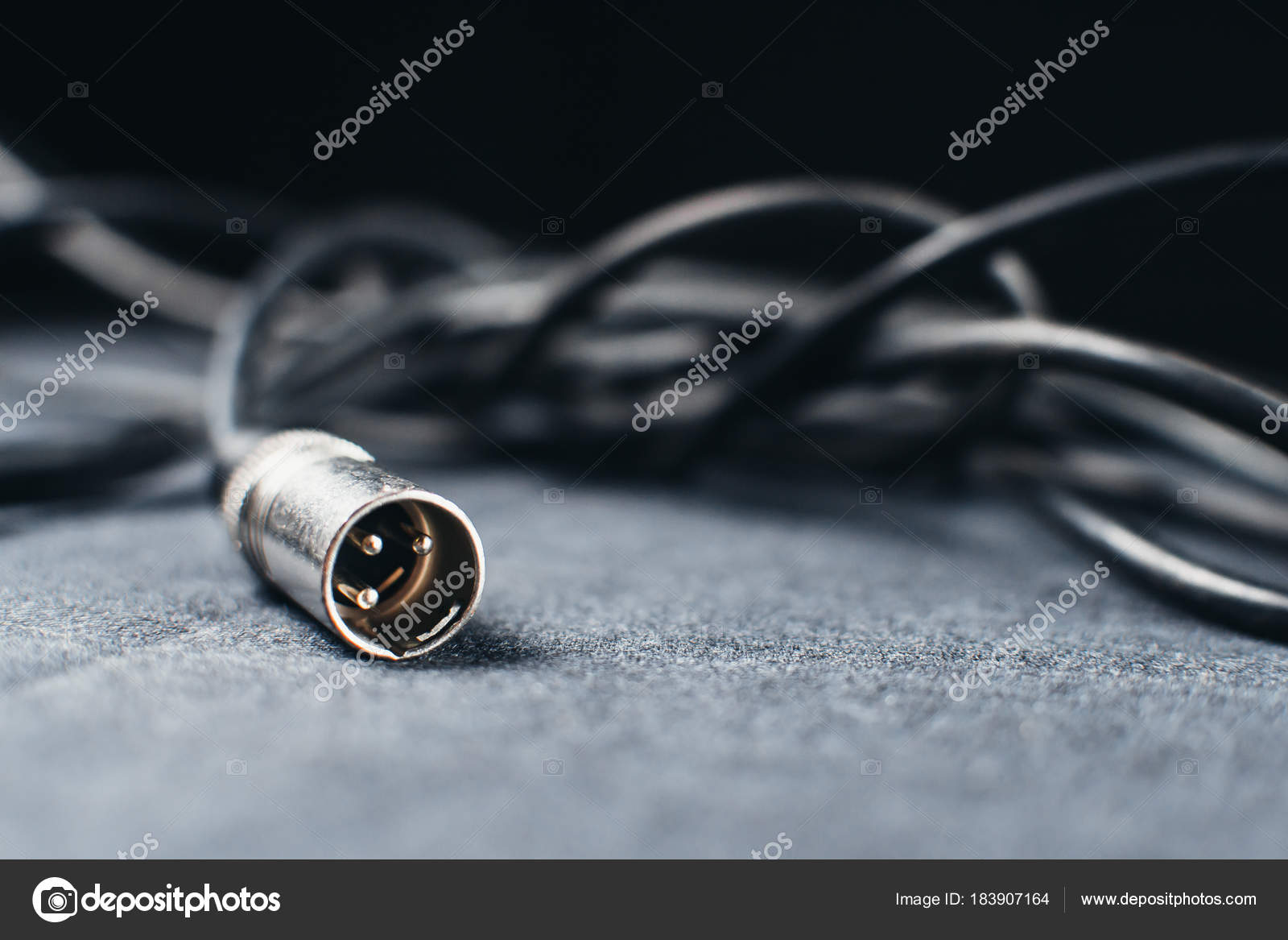 XLR, connector with wires on a dark fabric background in the Studio ...