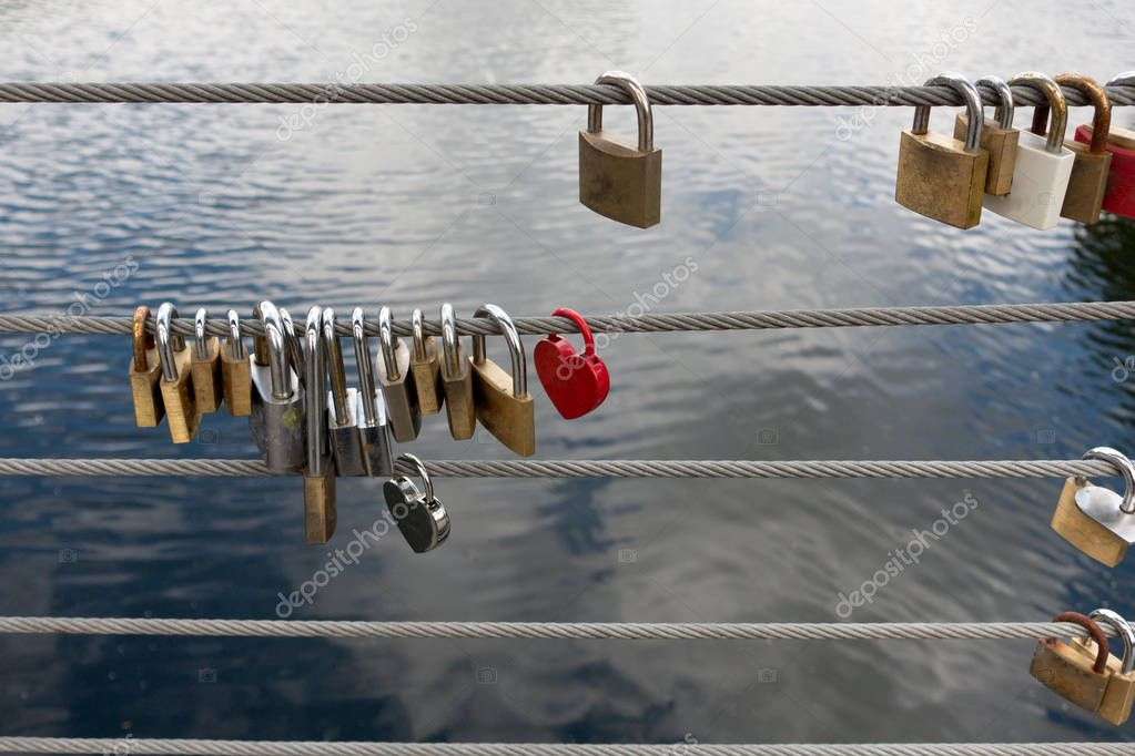 Padlocks on the side of a bridge, safety wires