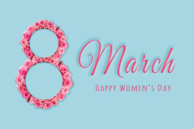 Greeting card international women's day March 8.Delicate pink roses in the shape of an eight on a blue background. Holiday.A congratulatory banner.sale.Mock up.Copy space.Flat lay