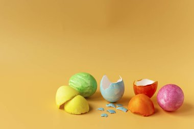 Colored eggs on an orange background. Easter holiday, family traditions. Easter eggs.