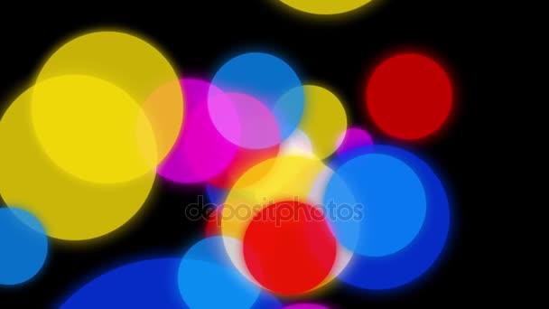 Kruhy na pozadí animace. Barevné kruhy pomalu rozptýlí v různých směrech na tmavém pozadí