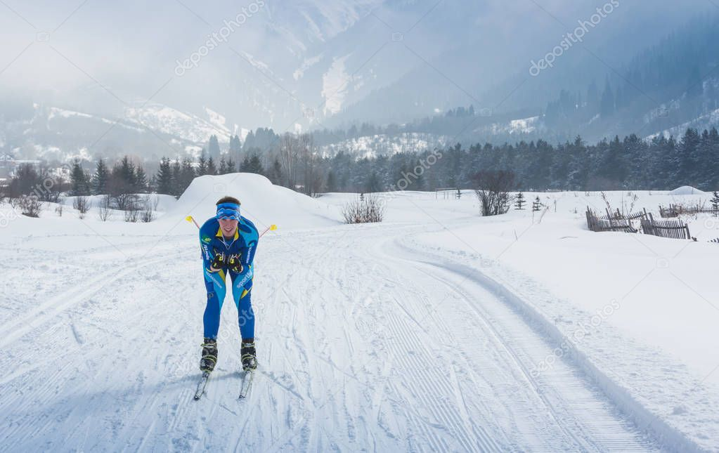 ALMATY, KAZAKHSTAN - FEBRUARY 18, 2017: amateur competitions in the discipline of cross-country skiing, under the name of ARBA Ski Fest. A man cross-country skiing on the trail in Almaty mount