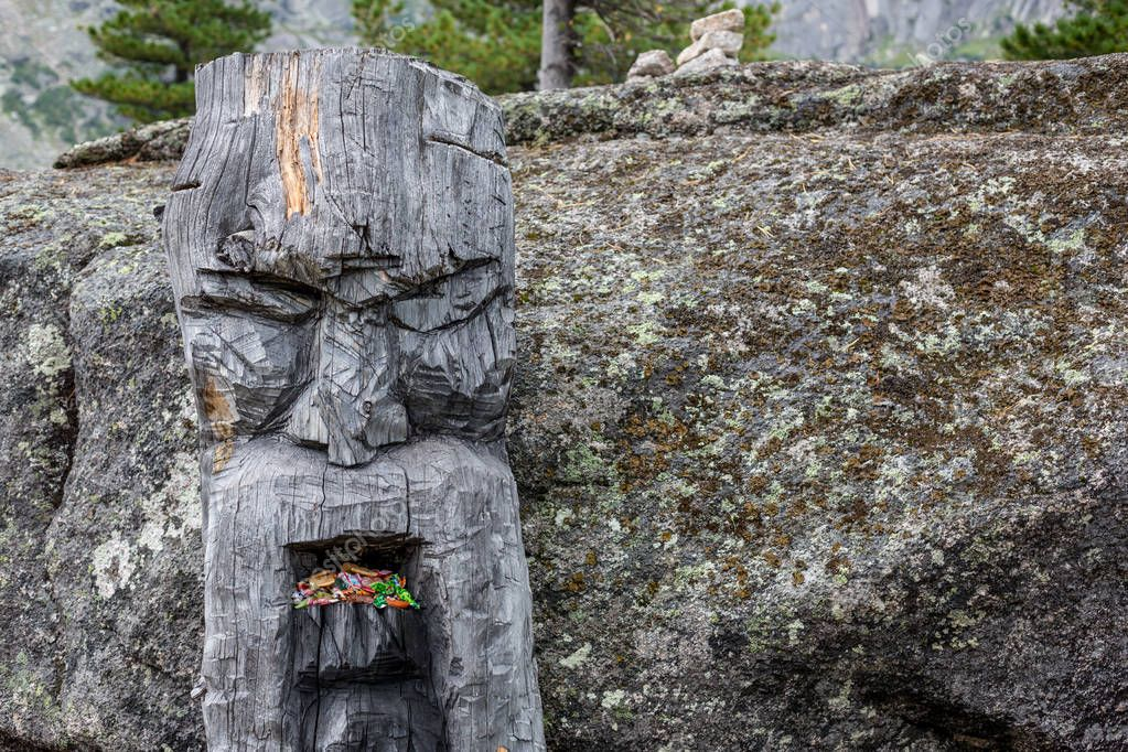 wooden statue of the Slavic god Perun in the Ergaki national park, Russia