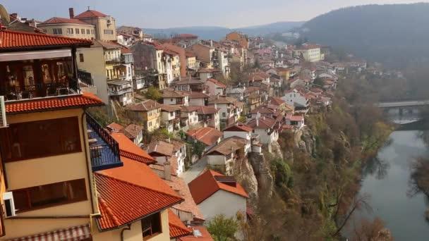Sunset in Veliko Tarnovo, a city in north central Bulgaria. Zoom in to the domes of Rozhdestvo Bogorodichno.